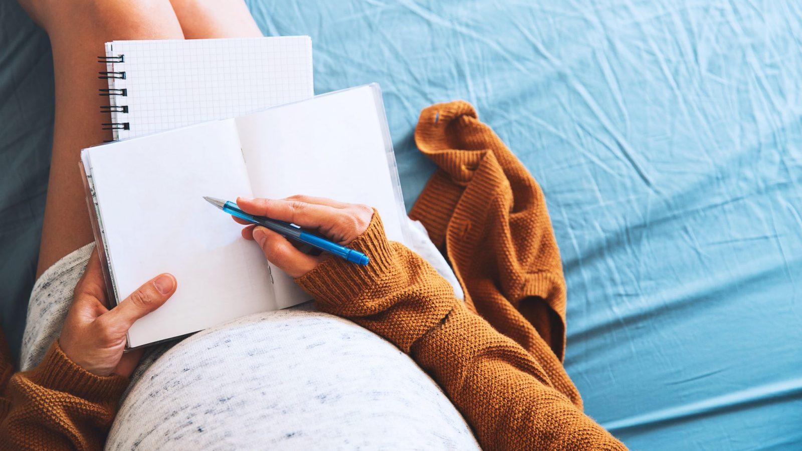 Pregnant woman writing her birth plan