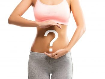 woman with question mark over her abdomen