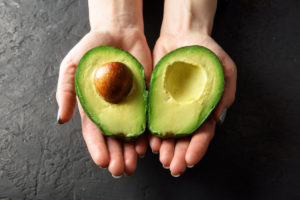hands-holding-an-avocado